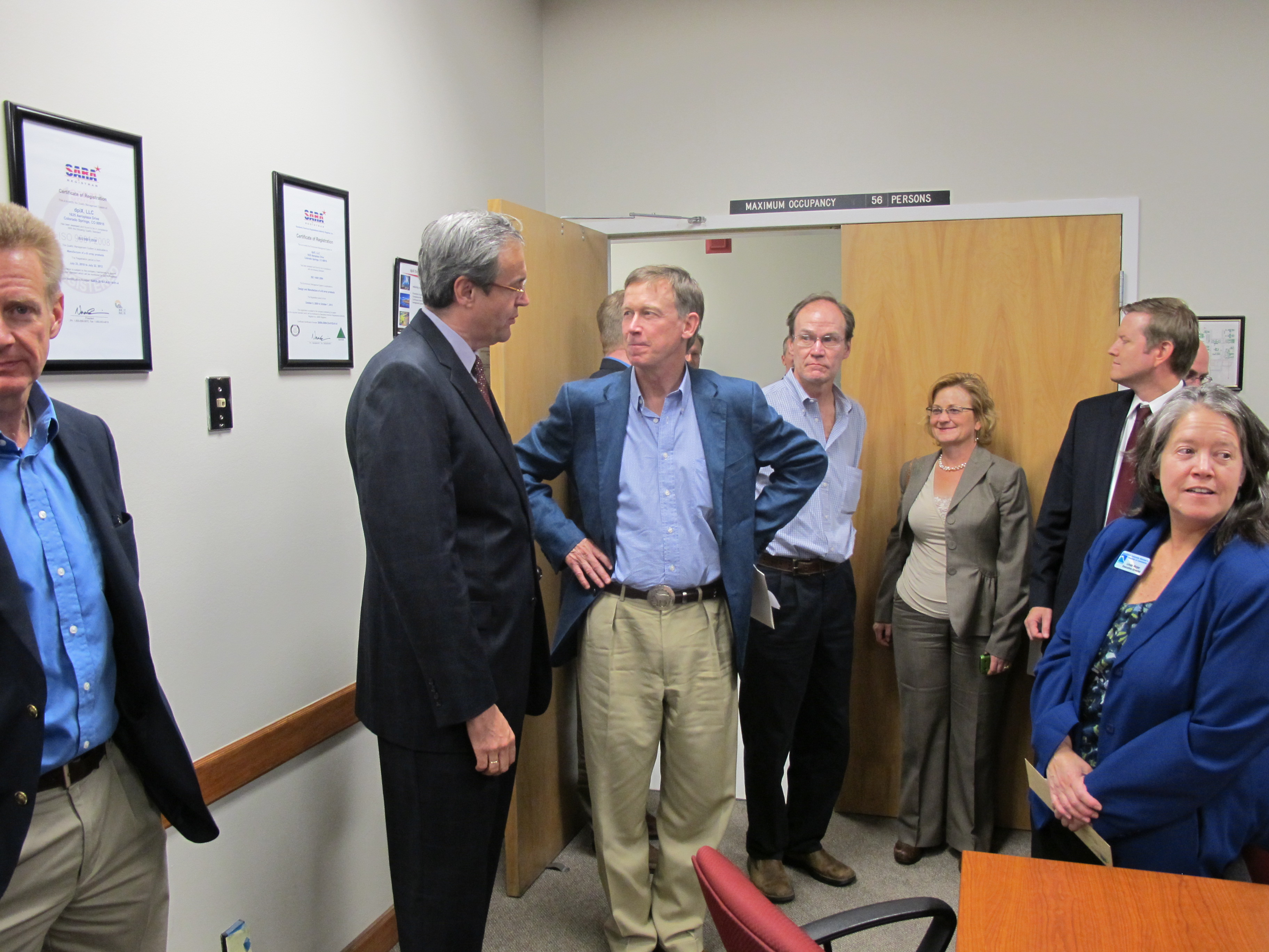 Chamber is all in for governors colorado blueprint john hickenlooper center blue jacket talks with dpix president ceo frank caris at july 26 tour of new company headquarters in colorado springs malvernweather Choice Image